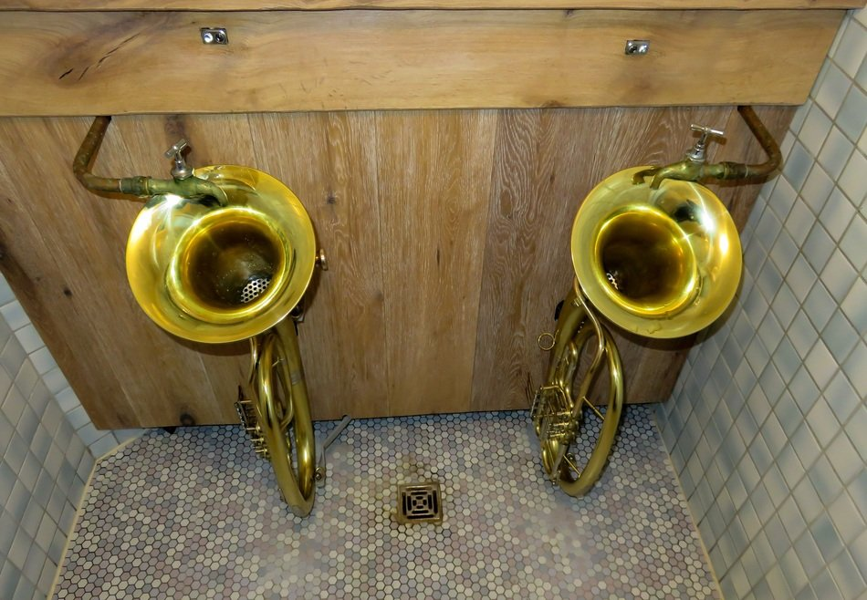 public toilet with trumpets