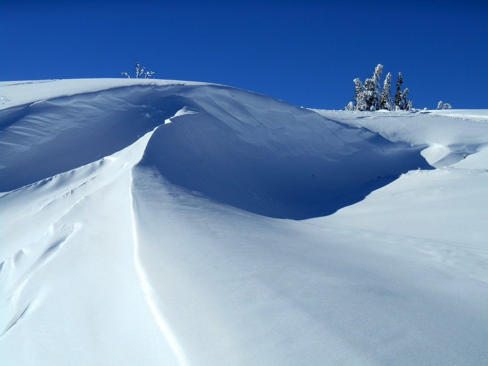 snow on a slope on a sunny day