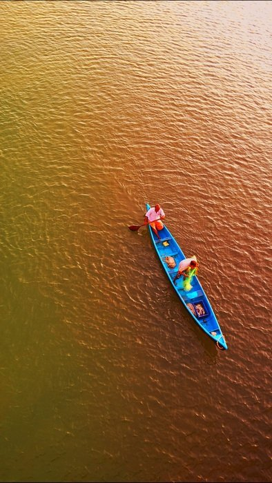 two Fishermen in blue Boat, top view