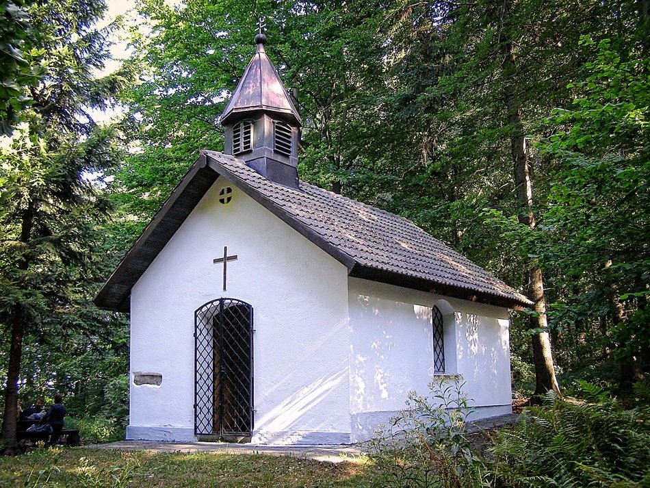 old white Chapel in Forest at summer
