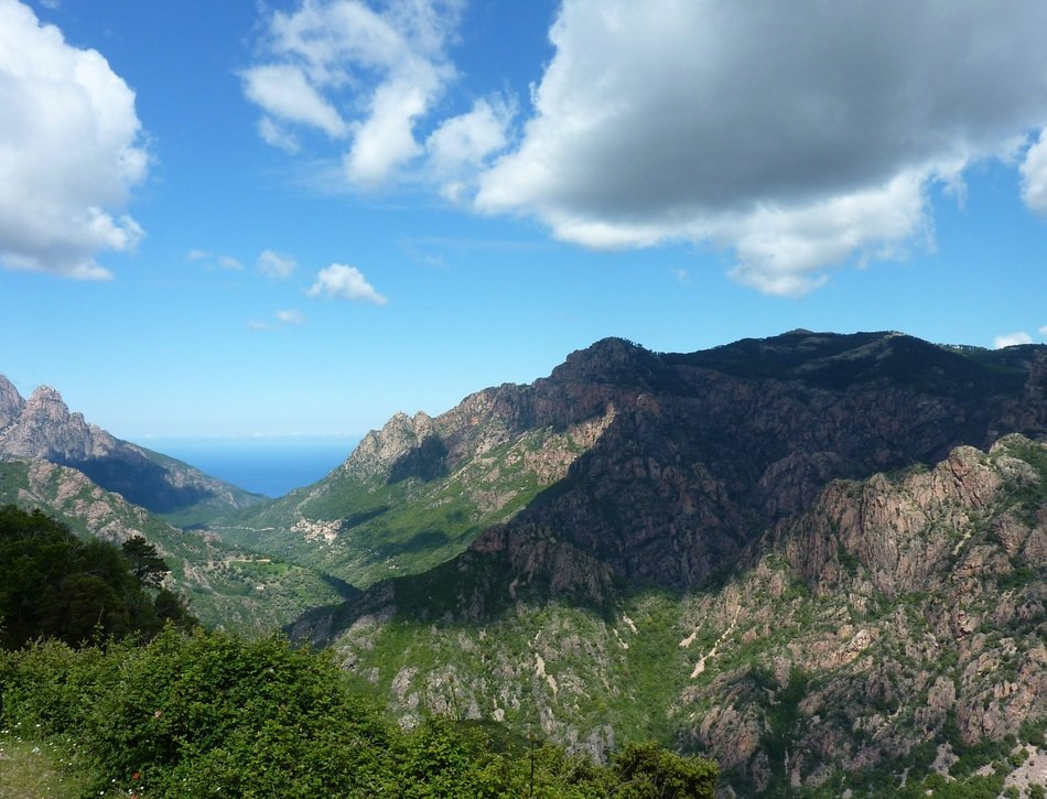 Beautiful panorama of the green mountain range in Corsica, France