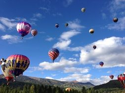 colorful Balloons in Sky above Mountains