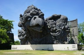large stone sculpture in a park in bali