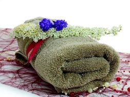 flowers lie on a green towel