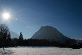 bright sun over picturesque winter alpine landscape