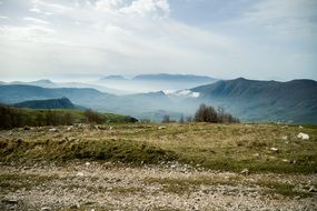 panorama of a valley in the clouds in the mountains of italy