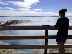 girl over geothermal springs in Yellowstone National Park