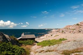 Summer landscape with house on rocky coastline at deep blue Sea, finland, åland