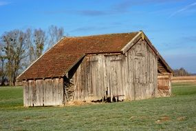 old wooden barn in a field in upper bavaria