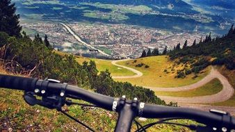 bicycle handlebar in view of beautiful mountain landscape, Mountain Biking