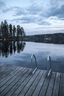 wooden flooring near a lake in finland