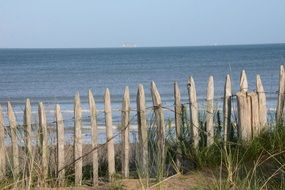wooden fence as protection on the seashore