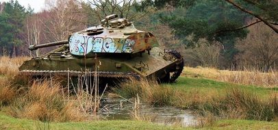old tank in the autumn forest