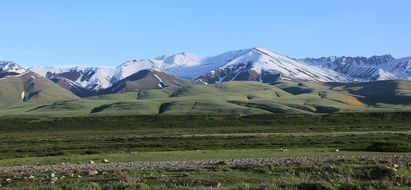 green and snow-capped Mountains in beautiful landscape, Kyrgyzstan