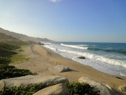 panorama of a sunny beach in tayrona national park in colombia