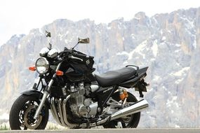 black motorcycle on a background of mountains