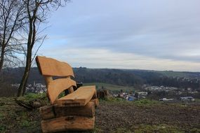 wooden bench on a hill above the village