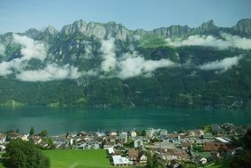 village at mountain lake, summer Landscape, Switzerland