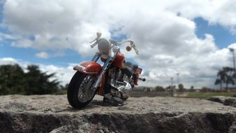 harley davidson motorcycle, miniature model on stone outdoor