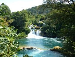 distant view of a waterfall in a park in croatia