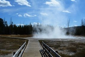 wooden bridge over hot springs in Yellowstone National Park