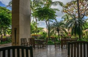 chairs and tables on terrace at palm trees, usa, Hawaii, Oahu, Resort Ko Olina