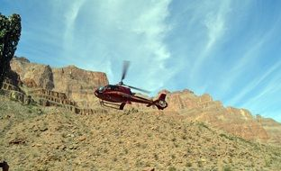 red helicopter over the grand canyon