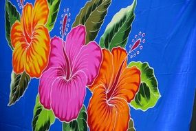 colorful big flowers on a blue towel