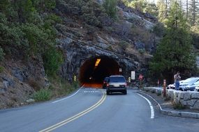 cars in front of a tunnel in yosemite national park