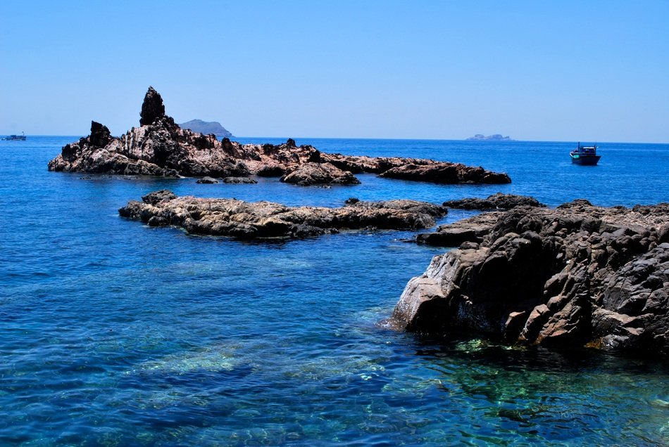 bright blue sea water rock coast view