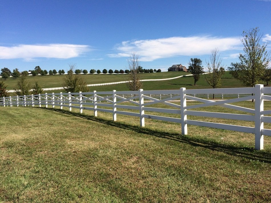 white wooden fence on a farm
