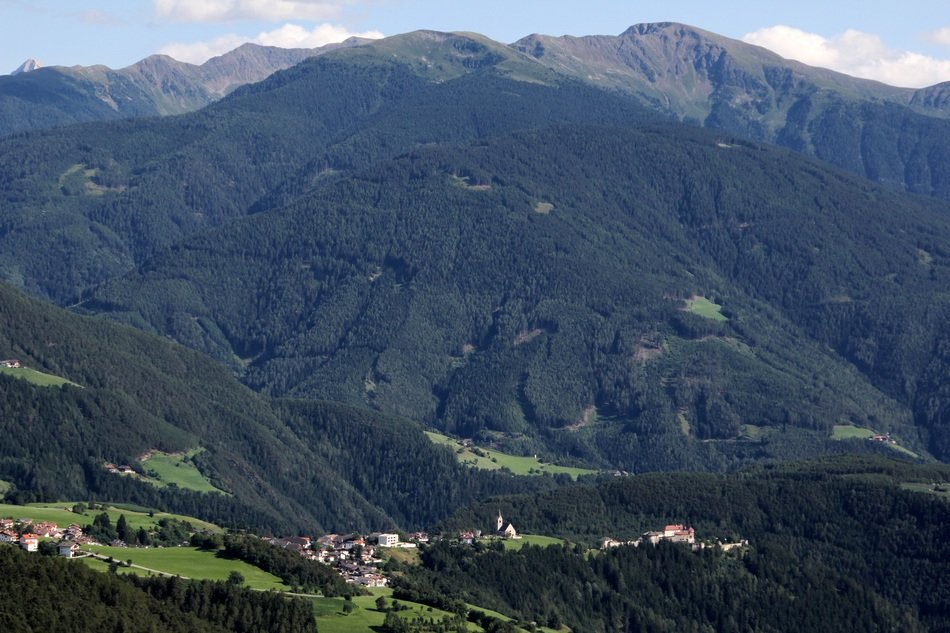 distant view of a village in a valley in the tyrol mountains