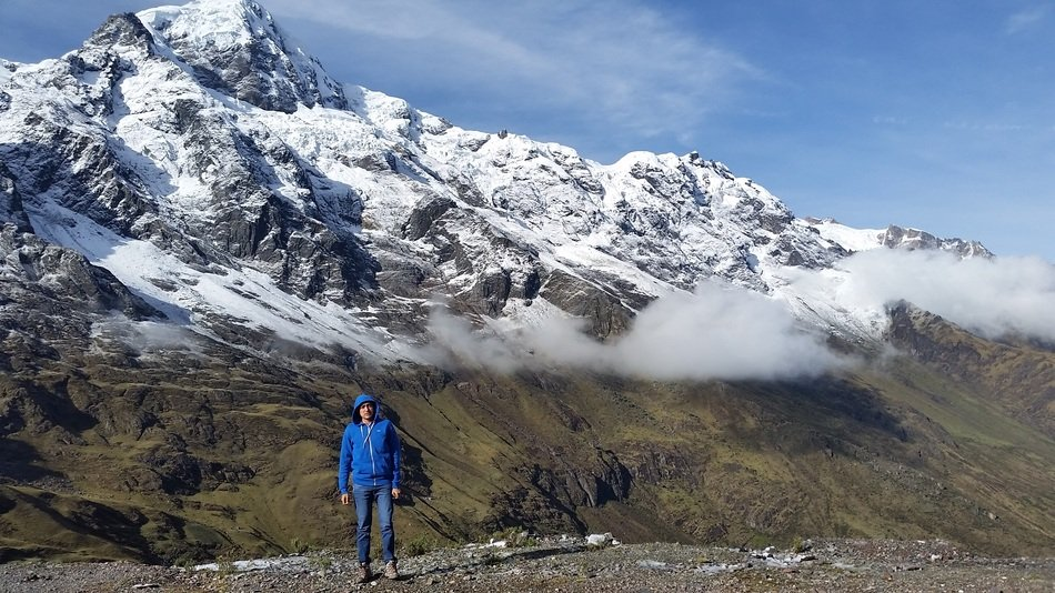 man in a blue jacket in the andes in peru