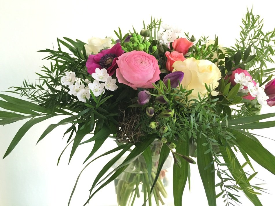 bouquet of flowers with palm leaves