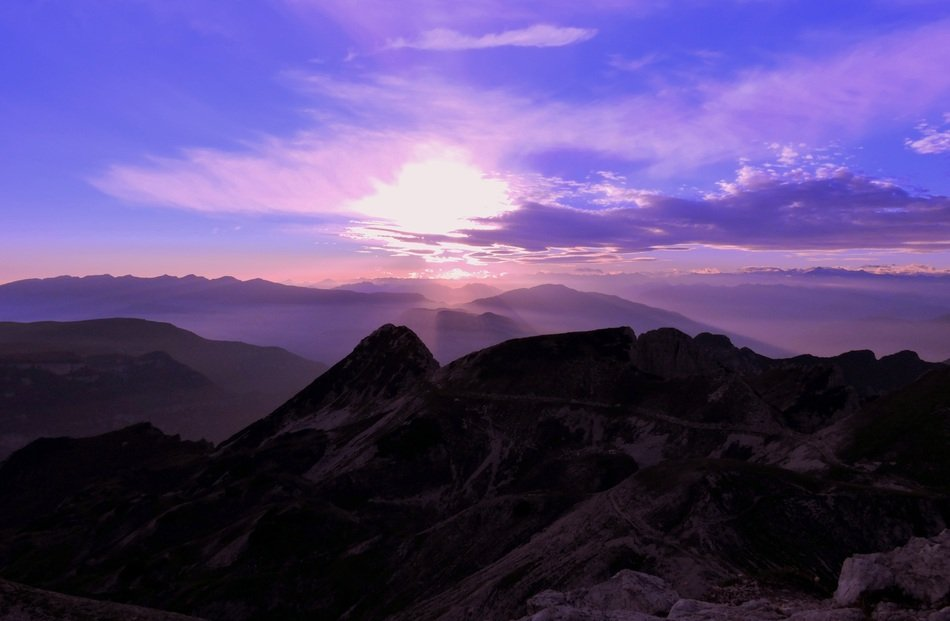 purple sunset over the mountains in italy