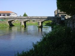 distant view of a stone bridge over a river