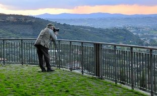 photographer takes a panorama of the city of Perugia from an observation deck, Italy