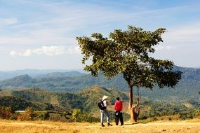 photo of tourists on the background of the mountains of Kalaw, Myanmar