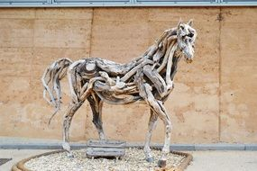 sculpture of a horse from branches