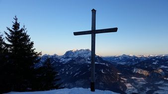 large cross on top of the Kaiser mountains
