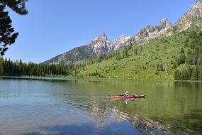 canoe on a picturesque lake in Grand Teton National Park