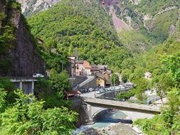 village, winding road and high bridge over a mountain river in Saint-Sauveur-sur-Tignes