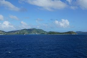 view from the water on the rocky coast of the british virgin islands