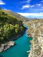 panorama of a turquoise river in a gorge in new zealand