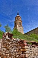 distant view of a church on a hill in albarracin