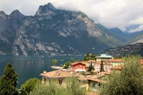 residential buildings on the shores of Lake Garda on a background of mountains in Italy
