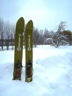 green skis in deep snow