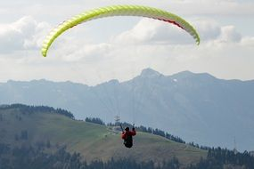 paraglider in the alpine sky