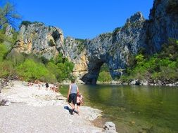 people resting on bank of ardeche river in scenic Landscape