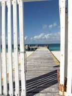 wooden pier on the beach in mexico